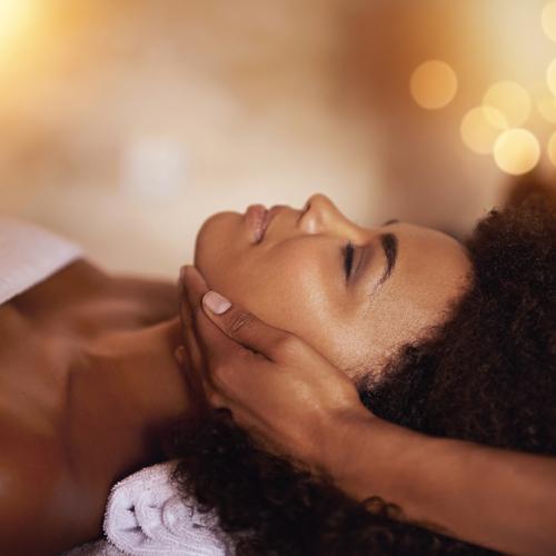 black woman getting a facial massage